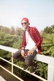 Cheerful dark skinned young guy wearing sunglasses Stock Photos