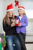 Cheerful Daughter And Mother With Christmas Stock Images