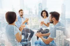 Smiling pleasant colleagues clapping hands Stock Photos