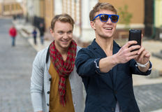 Cheerful day of twin brothers. Two stylish and handsome adult tw Stock Image