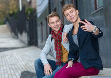 Cheerful day of twin brothers. Two stylish and handsome adult tw Royalty Free Stock Images