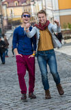 Cheerful day of twin brothers. Two stylish and handsome adult tw Royalty Free Stock Image
