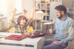 Cheerful delighted boy winning the chess game Stock Images