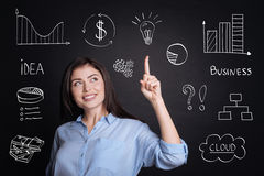 Cheerful delighted businesswoman having an idea. Stock Photos