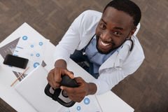 Cheerful delighted scientist looking at you Stock Photo