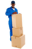Cheerful delivery guy preparing receiving notice Stock Images