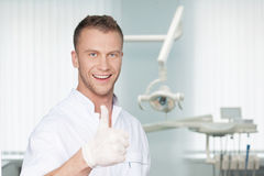 Cheerful dentist. Royalty Free Stock Photos