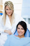 Cheerful dentists assistant with patient Royalty Free Stock Photos