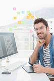 Cheerful designer with glasses using digitizer Royalty Free Stock Photo