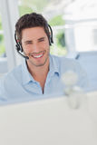 Cheerful designer having a video chat in his office Stock Photos