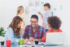 Cheerful designers brainstorming together Stock Image