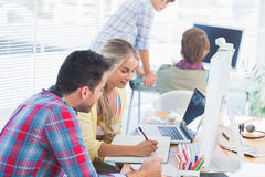 Cheerful designers working on a document Stock Photography