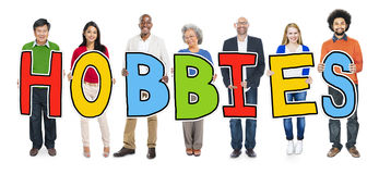 Cheerful Diverse Business People and Text Hobbies.  Stock Photo