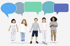 Cheerful diverse children holding hands royalty free stock photo