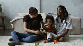 Cheerful diverse family with son relaxing at home stock footage