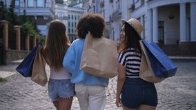 Cheerful diverse friends smiling while shopping stock video footage