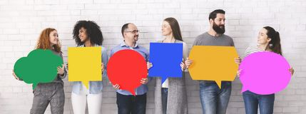Cheerful diverse people holding empty colorful speech bubbles royalty free stock photo