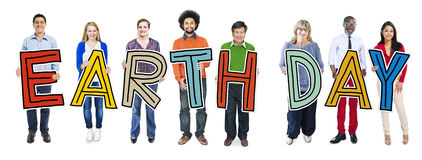 Cheerful and Diverse People Holding Text Earth Day Stock Photos