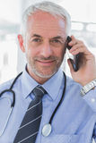 Cheerful doctor calling Stock Photography