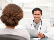Cheerful doctor dring an appointment Stock Image