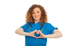 Cheerful doctor forming heart shape Royalty Free Stock Photos
