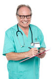 Cheerful doctor gathering information from patient Stock Photos