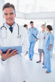 Cheerful doctor holding digital tablet Stock Photo