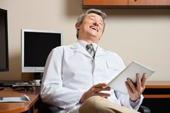 Cheerful Doctor Holding Digital Tablet Stock Images