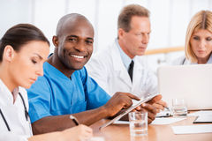Cheerful doctor at the meeting. Royalty Free Stock Photography