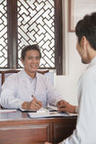 Cheerful Doctor Meeting with a Patient Stock Photography