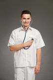 Cheerful doctor posing with stethoscope Royalty Free Stock Photo