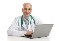 Cheerful doctor sitting at the desk Stock Photo