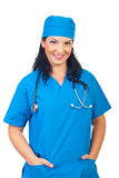 Cheerful doctor woman in blue uniform stock image