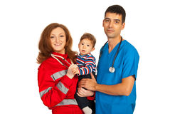 Cheerful doctors holding baby Royalty Free Stock Image