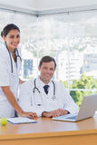 Cheerful doctors posing together in their office Stock Photo