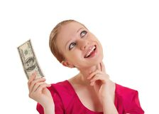 Cheerful dreamy girlholds the money Stock Photos