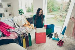 Cheerful ecstatic lovely beautiful pretty cute she her lady opening unpacking unwrapping red bag taking new best like stock photos