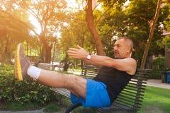 Cheerful elderly man doing exercises Stock Photo