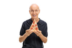 Cheerful elderly man holding a slice of pizza Royalty Free Stock Photography