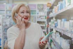 Lovely senior woman shopping at drugstore royalty free stock photos
