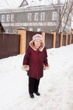 Cheerful elderly woman in winter Stock Photo