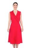 Cheerful elegant brunette in red dress posing Royalty Free Stock Photo