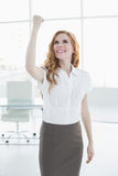 Cheerful elegant businesswoman cheering in office Royalty Free Stock Photography
