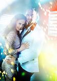 Cheerful, elegant couple in anightclub Stock Images