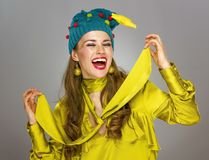 Cheerful elegant woman in funny Christmas hat isolated on grey Royalty Free Stock Photo