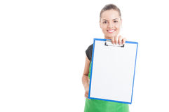 Cheerful employee holding clipboard with blank paper Stock Image