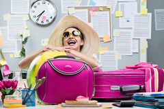 Cheerful employee leaving for vacations Stock Photography