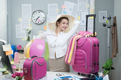 Cheerful employee leaving for vacations Royalty Free Stock Photography