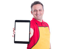 Cheerful employee showing his work tablet. With blank screen and advertising area Royalty Free Stock Images