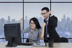 Cheerful employees expressing their winning Stock Image